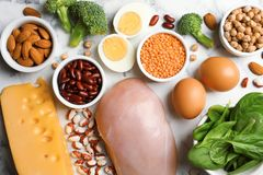 Set of natural food high in protein on marble background. Top view royalty free stock photography