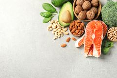 Set of natural food high in protein and space for text on grey background. Top view royalty free stock photo
