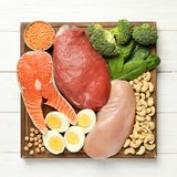 Set of natural food high in protein on wooden background. Top view royalty free stock photo