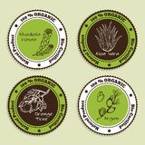 Set of Natural Organic Product badges. Labels for Essential Oils. Aloe Vera, Rhodiola Rosea, Orange Tree, Argan Royalty Free Stock Photo