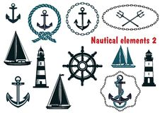 Set of nautical heraldry themed elements. Set of nautical heraldry themed design elements with assorted anchors crossed tridents sailboat yacht two lighthouses Royalty Free Stock Photography