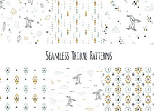 Set of navajo tribal patterns with low poly penguins. Stock Photos