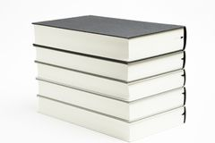 A Set Of Neatly Stacked Monochromatic Cloth Bound Books royalty free stock image