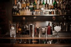 Set of necesary barman equipment on the bar counter. On the blurred background of the bar royalty free stock photos