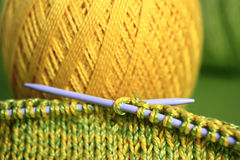 Set for needlework. Threads and needles on a green background Stock Photo