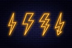 Set of neon lightning bolt signs. Neon sign of electricity or high-voltage symbol on brick wall background royalty free illustration