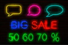 Set of neon signs with luminous for sales. Speech bubbles, title Big Sale and 50, 60, 70 per cent sale off. royalty free illustration