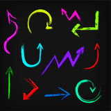 Set of neon vector arrows on a black background. Royalty Free Stock Photos