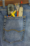 set of network instruments in a back pocket of  jeans Stock Image
