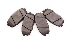 Set of new automobile brake pads Royalty Free Stock Photos