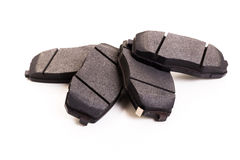 Set of new automobile brake pads. On a white background Royalty Free Stock Photos