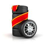 Set of new car tires. Set of new car or automobile tires with red ribbon, white background Royalty Free Stock Photos