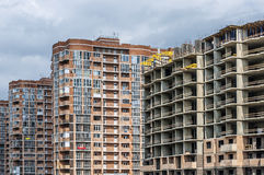 A set of new high-rise residential buildings. A set of new and under construction high-rise residential buildings against the sky Stock Images