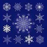 Set of New Year decorative snowflakes on a blue background Royalty Free Stock Images
