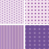Set of nice simple patterns. Set of nice simple seamless patterns in violet color scheme Royalty Free Stock Images