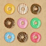Set of nine bright tasty vector donuts illustration on the cardboard box background. Doughnut icon in cartoon style Stock Image