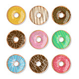 Set of nine bright tasty vector donuts illustration isolated on the white background. Doughnut icon in cartoon style Royalty Free Stock Photography