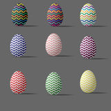 Set of nine colored wavy Easter eggs. Royalty Free Stock Photography