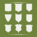 Set of nine  different forms of shields. Design elements: nine blank forms flat shields made old texture Stock Photography