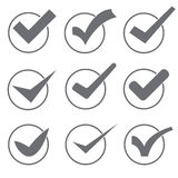 Set of nine different grey and white vector check marks or ticks. On a white background Royalty Free Stock Photo