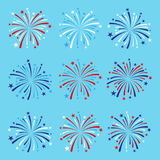 set of nine fireworks in blue, red and white colors. EPS Royalty Free Stock Images