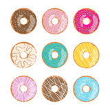 Set of nine glazed donuts in different colors isolated on the white background. Stock Images