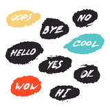 Set with nine hand drawn grunge greeting emotial phrases in speech bubbles Royalty Free Stock Image