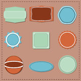 Set of  labels. Set of nine labels in blue, green and brown. Vector illustration Stock Photos