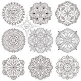 A set of nine mandalas. A set of nine mandalas in the style of boho. Abstract circular pattern of contour lines Royalty Free Stock Photo