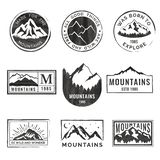 Set of nine mountain travel emblems with grunge texture. Camping outdoor adventure emblems, badges and logo patches. Set of nine mountain travel emblems with vector illustration