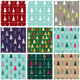 Set of nine seamless Christmas  pattern with fir-trees, snowflakes, garlands. In a vintage style Royalty Free Stock Photo