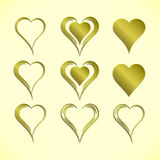 Set of nine simple isolated vector hearts with golden metallic pattern Royalty Free Stock Photo