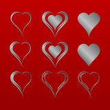 Set of nine simple isolated vector hearts with silver metallic pattern Royalty Free Stock Photography