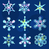 Set of nine sparkling snowflakes. Sparkling hexagonal snowflakes in the cold scale Royalty Free Stock Photos