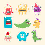 Set of nine stickers with cartoon cute monsters. Stock Photography