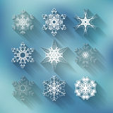 Set of nine vector different snowflakes on blue Stock Photo