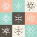 Set of nine vector simple linear snowflakes icons on multicolor Stock Photos