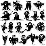 Set of nineteen flying black ghost stencils. Collection of nineteen amusing flying black Halloween phantom stencils with various characters isolated on a white Royalty Free Stock Photography