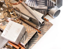 A set of non-ferrous metals. Products from aluminum, copper, bronze and brass on a white background Stock Image