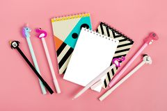 Set of notebooks for notes and pens on pink background Place for text Flat lay Top view Goals,Means, Resolution concept. Mock up stock photos