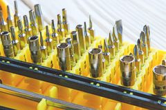 A set of nozzles of different sizes for screwdriver close-up in a yellow box, daddy`s Toolbox. A set of nozzles of different sizes for screwdriver close-up in a Stock Photo