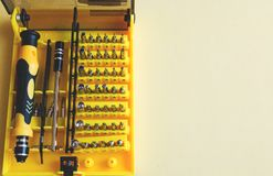 A set of nozzles of different sizes for screwdriver close-up in a yellow box, daddy`s Toolbox royalty free stock photos