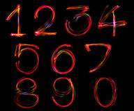 Set of number writing from light. Royalty Free Stock Images