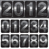 Set of Numbers on Mechanical Timetable Stock Image