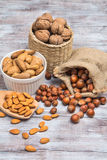 Set of nuts almonds, walnuts, hazelnuts on wooden table Stock Photography