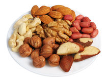 Set of nuts on a white plate, isolated Royalty Free Stock Photography