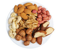 Set of nuts on a white plate, isolation Stock Photo