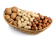 Set of nuts in a wicker basket, isolation Royalty Free Stock Photos