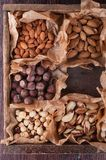 Set of nuts in a wooden box Royalty Free Stock Photos
