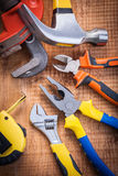 Set o f tools on wooden board tapeline adjustable Royalty Free Stock Photos